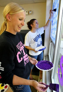 Mike Greene - mgreene@shawmedia.com Juniors Lisa Semro (left), 16, and Jamie Deering, 16, laugh while working on a window for varsity softball during window decorations for homecoming Wednesday, October 3, 2012 at Cary-Grove High School in Cary. Homecoming festivities will culminate in parades Saturday morning before a varsity home football game against Huntley at 1PM.