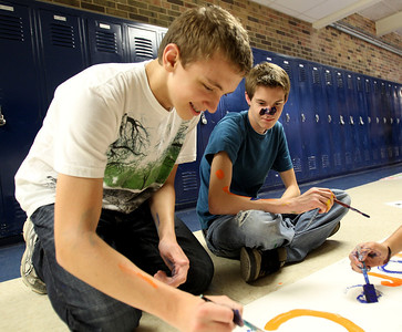 Mike Greene - mgreene@shawmedia.com Sophomore Chris Michols (right), 15, watches as classmate Jimmy Vitullo, 15 works on a banner during window decorations for homecoming Wednesday, October 3, 2012 at Cary-Grove High School in Cary. Homecoming festivities will culminate in parades Saturday morning before a varsity home football game against Huntley at 1PM.