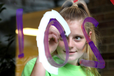 Mike Greene - mgreene@shawmedia.com Sophomore Emily McCratic, 15, focuses while writing her classes graduation year during window decorations for homecoming Wednesday, October 3, 2012 at Cary-Grove High School in Cary. Homecoming festivities will culminate in parades Saturday morning before a varsity home football game against Huntley at 1PM.