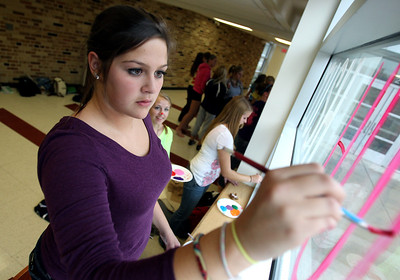 Mike Greene - mgreene@shawmedia.com Sophomore Emily Kuperman, 15, works on a frosh/soph cheer window during window decorations for homecoming Wednesday, October 3, 2012 at Cary-Grove High School in Cary. Homecoming festivities will culminate in parades Saturday morning before a varsity home football game against Huntley at 1PM.