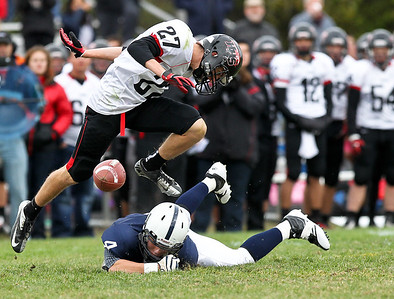 Josh Peckler - Jpeckler@shawmedia.com Huntley's Josh Sepsey jumps over Cary-Grove's Ethan Connor after breaking up a pass during the third quarter at Cary-Grove High School Saturday, October 6, 2012. Cary-Grove defeated visiting Huntley 41-14.