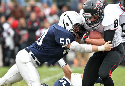 Josh Peckler - Jpeckler@shawmedia.com Huntley's Tyler Schwartz (8) is hit by Cary-Grove's Emerson Kersten  during the third quarter at Cary-Grove High School Saturday, October 6, 2012. Cary-Grove defeated visiting Huntley 41-14.