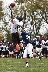 Josh Peckler - Jpeckler@shawmedia.com Huntley's Garrick McDaniel reaches up to catch a ball while being covered by Cary-Grove's John Walker during the third quarter at Cary-Grove High School Saturday, October 6, 2012. Cary-Grove defeated visiting Huntley 41-14.