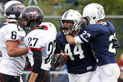 Josh Peckler - Jpeckler@shawmedia.com Cary-Grove's Kyle Norberg (44) celebrates with teammate Kasey Fields after he ran for a 66 yard touchdown during the third quarter at Cary-Grove High School Saturday, October 6, 2012. Cary-Grove defeated visiting Huntley 41-14.