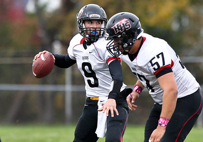 Josh Peckler - Jpeckler@shawmedia.com Huntley quarterback Kameron Sallee looks down field for a open receiver during the third quarter at Cary-Grove High School Saturday, October 6, 2012. Cary-Grove defeated visiting Huntley 41-14.