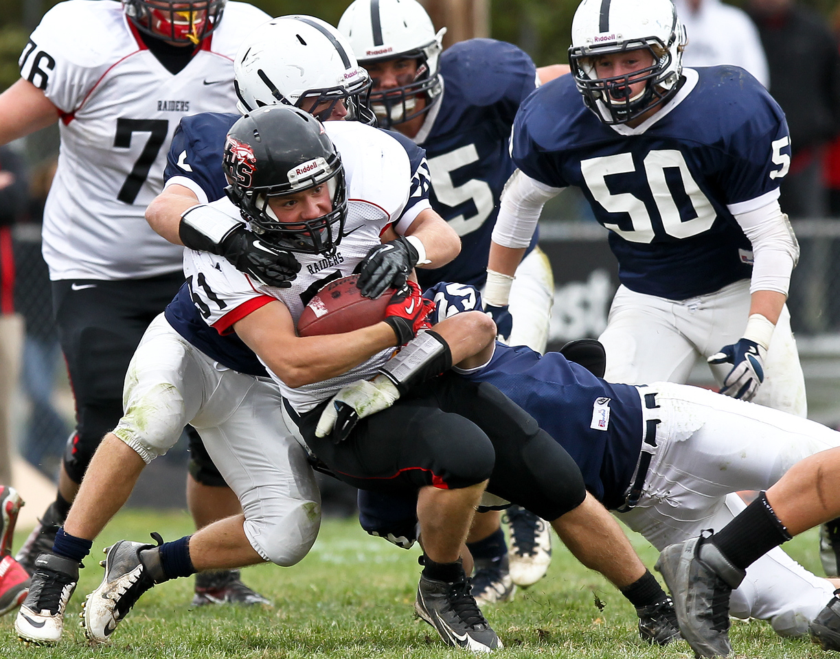Josh Peckler - Jpeckler@shawmedia.com Huntley's Jake Scalise (31) is tackled by several Cary-Grove defenders during the third quarter at Cary-Grove High School Saturday, October 6, 2012. Cary-Grove defeated visiting Huntley 41-14.