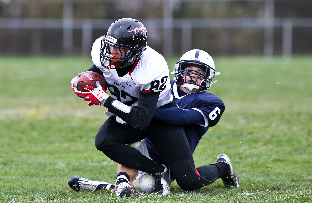 Josh Peckler - Jpeckler@shawmedia.com Huntley's Jake Lackovic is pulled down by Cary-Grove's Marcus Thimios during the fourth quarter at Cary-Grove High School Saturday, October 6, 2012. Cary-Grove defeated visiting Huntley 41-14.