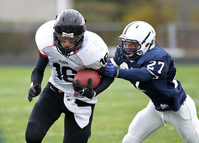 Josh Peckler - Jpeckler@shawmedia.com Cary-Grove's Brain Nordengren (27) tries to grab Huntley's Bryce Beschorner as he runs with the ball in the fourth quarter at Cary-Grove High School Saturday, October 6, 2012. Cary-Grove defeated visiting Huntley 41-14.