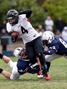 Josh Peckler - Jpeckler@shawmedia.com Huntley running back Ethan Connor (4) tries to escape from Cary-Grove defenders Matt Hughes (left) and Mickey Duncan during the fourth quarter at Cary-Grove High School Saturday, October 6, 2012. Cary-Grove defeated visiting Huntley 41-14.