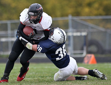 Josh Peckler - Jpeckler@shawmedia.com Cary-Grove's Matt Hughes (38) tries to tackle Huntley running back Ethan Connor during the third quarter at Cary-Grove High School Saturday, October 6, 2012. Cary-Grove defeated visiting Huntley 41-14.