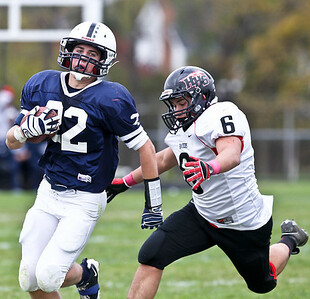 Josh Peckler - Jpeckler@shawmedia.com Cary-Grove's Kasey Fields (22) runs with the ball while being chased by Huntley's Brandon Mabry during the third quarter at Cary-Grove High School Saturday, October 6, 2012. Cary-Grove defeated visiting Huntley 41-14.