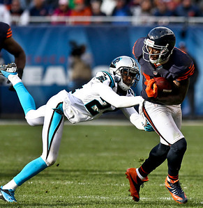 Josh Peckler - Jpeckler@shawmedia.com Chicago's Brandon Marshall tries to break away from Carolina's Josh Norman after receiving a pass during the fourth quarter at Soldier Field Sunday, October 28, 2012.