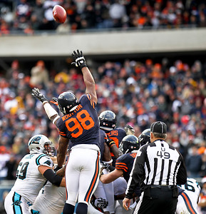 Josh Peckler - Jpeckler@shawmedia.com Chicago's Cory Wootton (98) reaches up to try and block a Carolina field goal during the third quarter at Soldier Field Sunday, October 28, 2012.