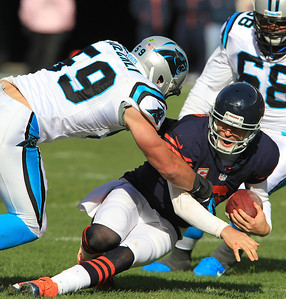 H. Rick Bamman - hbamman@shawmedia.com The Bears' Jay Cutler slides down for a short gain in the first half as Carolina's Luke Kuechly, (right) and Andre Neblett make the stop Sunday, October 28, 2012.