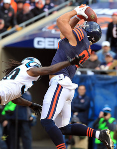 H. Rick Bamman - hbamman@shawmedia.com The Bears Kellen Davis snags a Jay Cutler pass for a touchdown past the Panthers's Charles Godfrey inthe secon quarter Sunday, October 28, 2012.