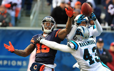 H. Rick Bamman - hbamman@shawmedia.com Carolina Panthers' Josh Norman intercepts a Jay Cutller pass intended for Brandon Marshall in the first quarter. Carolina's Haruki Nakamura takes Marshall out of the play Sunday, October 28, 2012. Bears won 23-22.