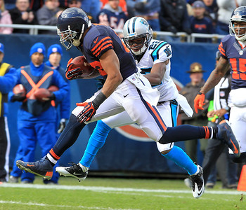 H. Rick Bamman - hbamman@shawmedia.com The Bears Matt Forte jumps into the end zone for the first quarter touchdown as the Panthers' Josh Thomas defends Sunday, October 28, 2012.
