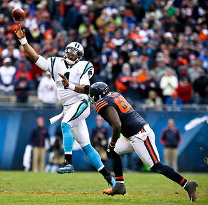 Josh Peckler - Jpeckler@shawmedia.com Carolina quarterback Cam Newton gets off a pass while being chased by Chicago's Henry Melton during the third quarter at Soldier Field Sunday, October 28, 2012.