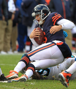 H. Rick Bamman - hbamman@shawmedia.com Jay Cutler is sacked by Carolina's Dwan Edwards in the first half Sunday, October 28, 2012.
