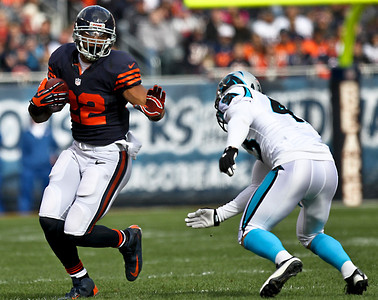 Josh Peckler - Jpeckler@shawmedia.com Chicago running back Matt Forte prepares to stiff arm Carolina's Haruki Nakamura during the second quarter at Soldier Field Sunday, October 28, 2012.