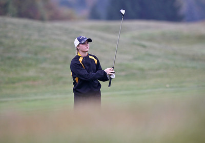 Josh Peckler - Jpeckler@shawmedia.com Jacob's Kaitlynn Woloszyk watches her shot on the 11th hole during the IHSA Girl's Golf Regional at the Golf Club of Illinois in Algonquin Wednesday, October 3, 2012.
