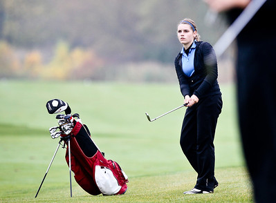 Josh Peckler - Jpeckler@shawmedia.com Marian Central's Samantha Leicht watches her chip shot on the 13th hole during the IHSA Girl's Golf Regional at the Golf Club of Illinois in Algonquin Wednesday, October 3, 2012.