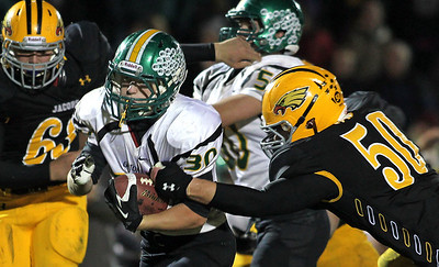 H. Rick Bamman - hbamman@shawmedia.com Crystal Lake South's Chris Ivers runs for a first down in the closing minutes of the fouth quarter while persued by Jacobs' Adam Kulon. South beat Jacobs 32-29 Friday, October 12, 2012.