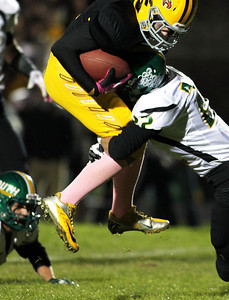 H. Rick Bamman - hbamman@shawmedia.com  Jacobs Hunter Williams holds on to a Bret Mooney pass for a gain of 15 yards for a first down in the first quarter as Crystal Lake South's Corbin Pennino maks the stop. South won 32-29.