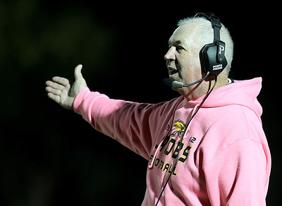 H. Rick Bamman - hbamman@shawmedia.com Jacobs's head coach Bill Mitz asks the officials why they did not allow him to call a time out prior to Crystal Lake South's field goal attempt in the last second of the fourth quarter. Crystal Lake South won 32-29.