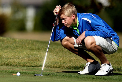 Sarah Nader - snader@shawmedia.com Crystal Lake South's Robert Wagner lines up his ball on the 16th hole during Tuesday's Crystal Lake South boys golf regional at Redtail Gold Club in Lakewood on October 2, 2012.