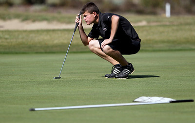 Sarah Nader - snader@shawmedia.com Huntley's Trent Craig lines up his putt on  the 6th hole during Tuesday's Crystal Lake South boys golf regional at Redtail Gold Club in Lakewood on October 2, 2012.