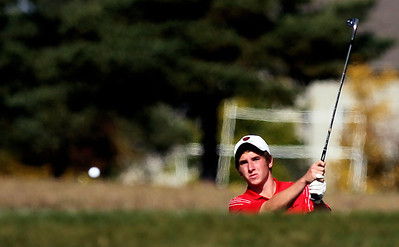 Sarah Nader - snader@shawmedia.com Palatine's Sean Temple hits out of a bunker during Tuesday's Crystal Lake South boys golf regional at Redtail Gold Club in Lakewood on October 2, 2012.