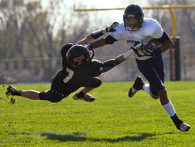 Brett Moist/ For the Northwest Herald Crystal Lake Central's Jordan Wallace dives to tackle Hyde Park's Kwanze Gibson during the 1st quarter of gameplay on Saturday.