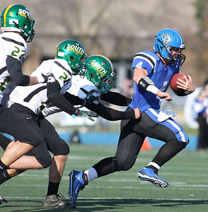 H. Rick Bamman - hbamman@shawmedia.com Crystal Lake South's Corbin Pennino (22), Brandon LaPak (21) and Brendan Chrystal (7) chase down Lake Zurich's Noah Allgood (4) in the second quarter of the Class 7A first round playoff game Saturday, October 27, 2012. Lake Zurich won 49-0.