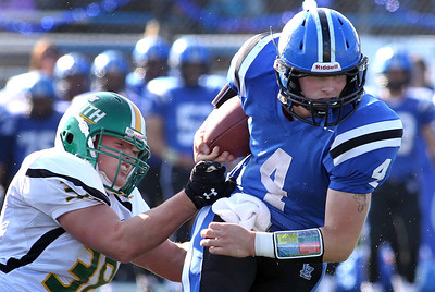 H. Rick Bamman -hbamman@shawmedia.com Crystal Lake South's John Fitzpatrick (38) slows down Lake Zurich's Noah Allgood (4) in the first quarter during the Class 7A first round play off game in Lake Zurich. Crystal Lake South was shut out 49-0 Saturday, October 27, 2012.