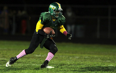 H. Rick Bamman - hbamman@shawmedia.com Crystal Lake South's Zevin Clark finds running room for a short gain in the center of the filed in the second quarter against Dundee-Crown.