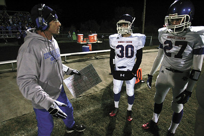 H. Rick Bamman - hbamman@shawmedia.com Dundee-Crown head coach Vito Andriola questions Ben Sprouse (center) and Fabian Gutierrez on the sideline at the start of the second half against Crystal Lake South.
