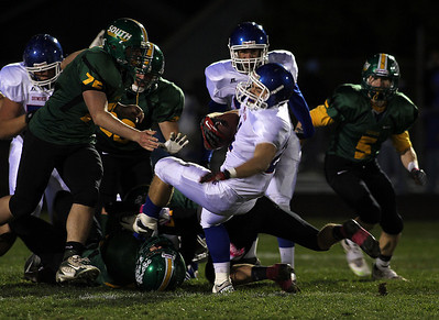 H. Rick Bamman - hbamman@shawmedia.com Dundee-Crown's Cody Lane spins for a first down in the first quarter.