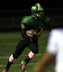 H. Rick Bamman - hbamman@shawmedia.com Crystal Lake South's Brandon Madoni returns a kick off in the second quarter.