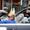 Isabelle Koester, 10, of Geneva watches from her family's van as the Geneva High School homecoming parade passes on State Street in downtown Geneva Friday night. (Sandy Bressner photo)