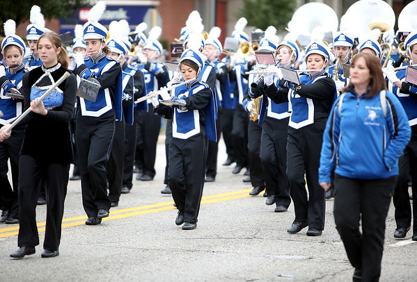 Members of the Geneva High School Marching Band participate in the school's annual homecoming parade on State Street in Geneva Friday afternoon. (Sandy Bressner photo)