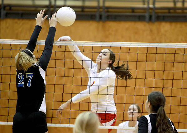 Batavia's Kristen Koncelik tries to get the ball past Geneva's Taylor Marmitt (27) during Geneva's 25-22, 21-25, 25-19 Batavia Regional final win Thursday night.
