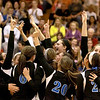 Geneva volleyball players celebrate their  25-22, 21-25, 25-19 Batavia Regional final win Thursday night.