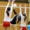 Geneva's Hannah Lanasa (16) spikes the ball over the net during their 25-22, 21-25, 25-19 Batavia Regional final win over Batavia Thursday night.