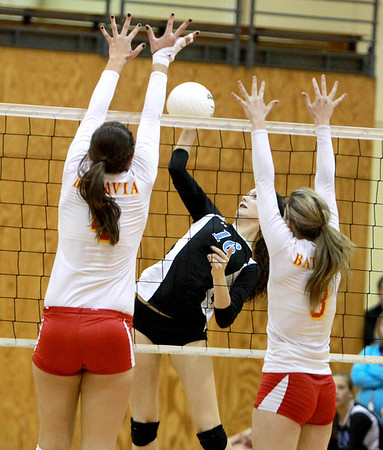 Geneva's Hannah Lanasa (16) spikes the ball over the net during their 25-22, 21-25, 25-19 Batavia Regional final win over Batavia Thursday night.