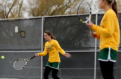 Sarah Nader - snader@shawmedia.com Crystal Lake South's Julia Thome (left) and Marisa Thome return the ball while competing in a doubles game during Thursday's state tennis tournament in Rolling Meadows on October 18, 2012.