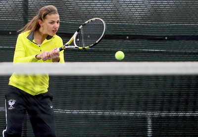 Sarah Nader - snader@shawmedia.com Kaneland's Angelica Emmanouil returns the ball while competing in a doubles game during Thursday's state tennis tournament in Rolling Meadows on October 18, 2012.