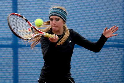 Sarah Nader - snader@shawmedia.com McHenry's Brittany Goebel returns the ball while competing in a singles game against Whitney Young during Thursday's state tennis tournament in Hoffman Estates on October 18, 2012.
