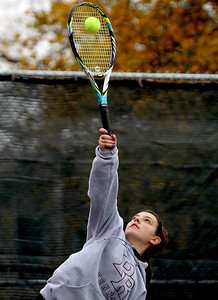 Sarah Nader - snader@shawmedia.com Prairie Ridge's Natalie Favia serves the ball while competing in a doubles game during Thursday's state tennis tournament in Rolling Meadows on October 18, 2012.