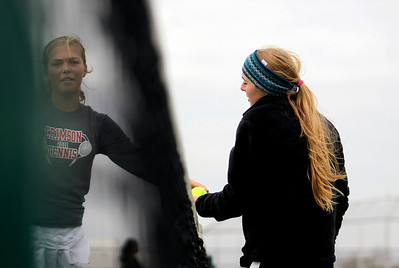 Sarah Nader - snader@shawmedia.com McHenry's Brittany Goebel (right) competes in a singles game against Whitney Young during Thursday's state tennis tournament in Hoffman Estates on October 18, 2012.